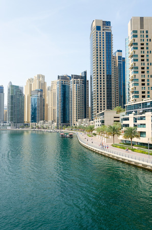 comprising: Dubai skyscraper architecture at Dubai Marina. One of the world�s largest man-made marinas, the Dubai Marina is a master-planned community comprising residential, commercial and public spaces.