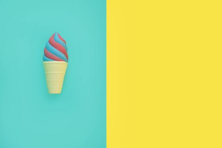 Flat lay antistress toy squish ice cream red blue in waffle cone.Bright blue yellow background.Compressing,soft,squeezable items to relieve stress,problems,anxieties,worries. Summer concept.
