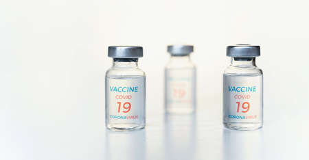 Closeup transparent vials with new vaccine for covid-19 coronavirus, flu, infectious diseases. Injection after clinical trials for vaccination of human, child, adult, senior. Medicine, drug concept.