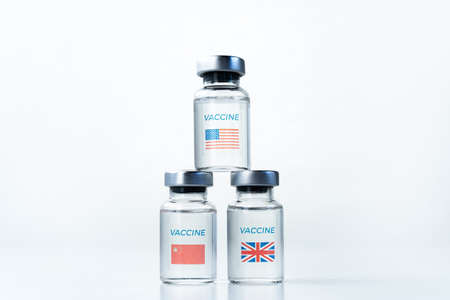 Transparent vials with USA, UK, China flag. New vaccine for covid-19 coronavirus, flu, infectious diseases. Injection after clinical trials for mass vaccination of human, people. Medicine, drug concept. Stock fotó