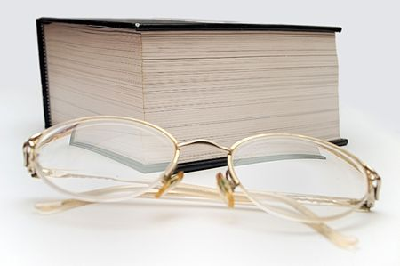 treatise: book and glasses