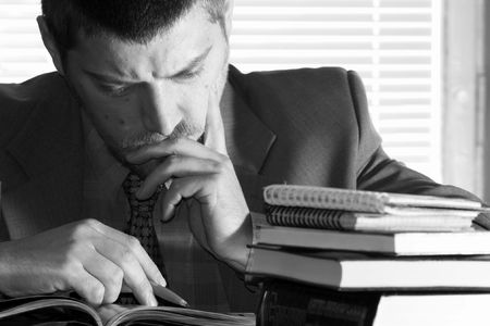 An image of businessman thinking over his papers Stock Photo - 2361553
