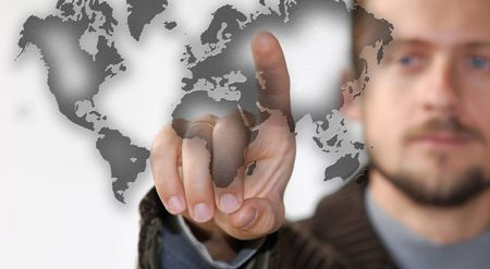 A bearded man pointing on to a map Stock Photo - 2361579