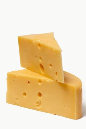 A piece of cheese on a white background