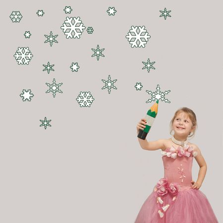 A girl in a pink dress drawing snow-flakes photo