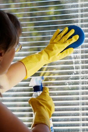 An image of woman cleaning a window photo