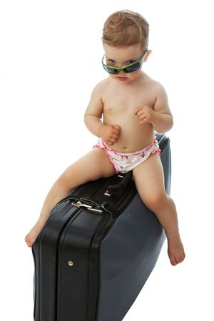 valise: A  on a valise looking from under goggles