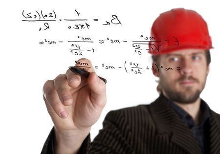 formule: An image of constructor in a rad helmet writing with a pen