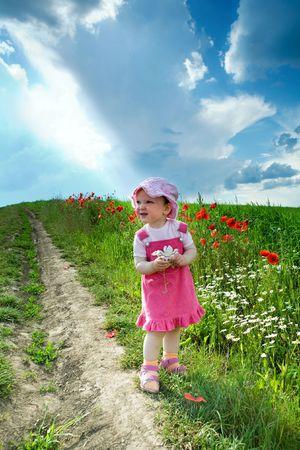 Child on the lane amongst green field Stock Photo - 3209933