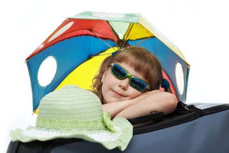 valise: A girl with umbrella on a valise Stock Photo