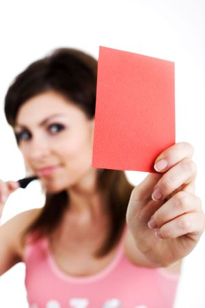 An image of a woman showing red card photo