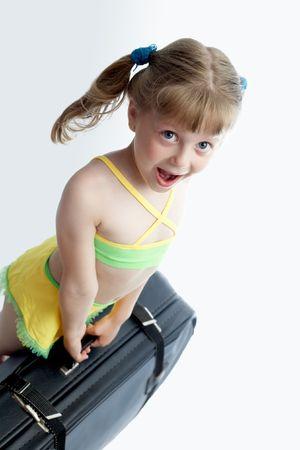 valise: Little girl lifting up heavy valise