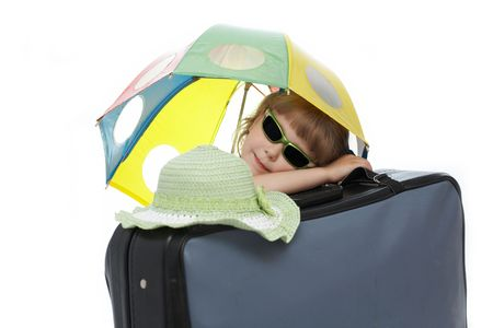 valise: Nice  girl with umbrella on a valise Stock Photo