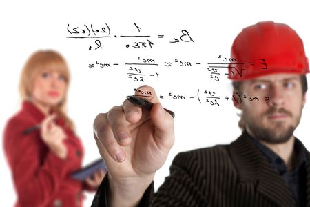 formule: An image of man in a rad helmet and woman with pen Stock Photo