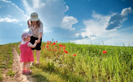 Ma with daughter amongst poppy-field