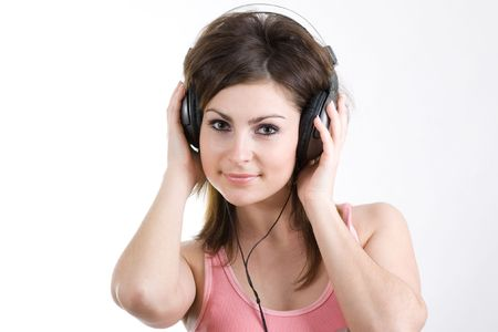 The woman listening to music photo