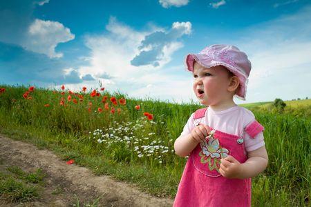 nice girl: Nice girl on the lane amongst green field Stock Photo