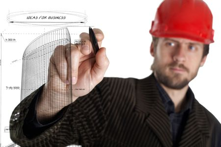 building planners: A planner in a rad helmet drawing with a pen