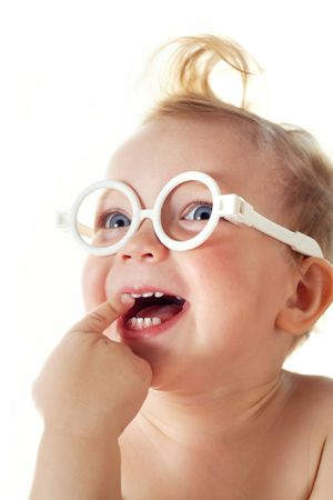 The cheerful little girl in glasses Stock Photo - 3375427