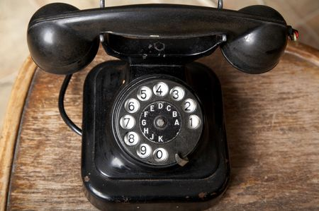An image of black retro telephone in the studio. photo