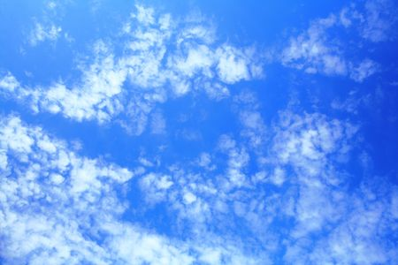 Blue sky with little clouds on it