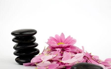clearness: A stack of black stones for SPA and flower