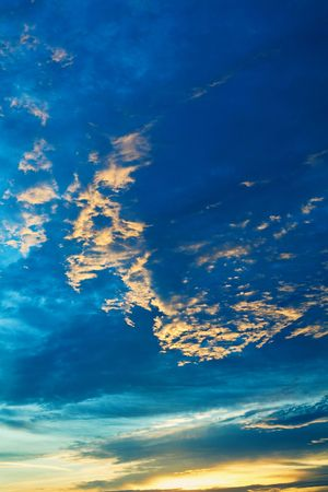 mistic: An image of dramatic sunset wit blue and orange clouds