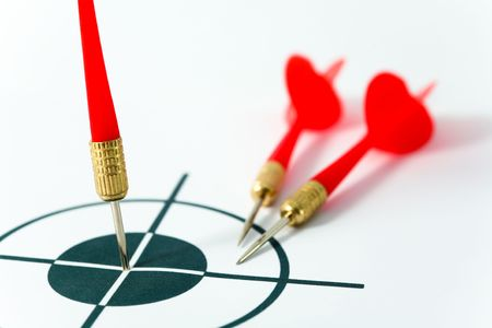 An image of tree darts and black target. Close up Stock Photo