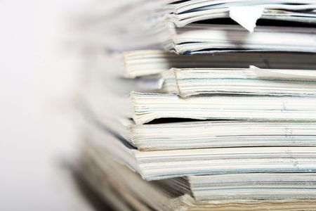 drudgery: Stack of paper on neutral background closeup