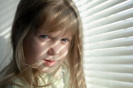 jalousie: A girl is looking in the window with jalousie