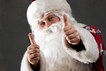 tumb: Santa Claus is preparing to celebrate Christmas. Showing tumb Stock Photo