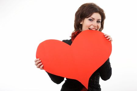 A woman biting a big red paper heart photo