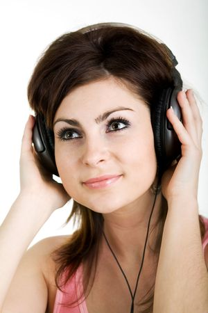The nice woman listening to music photo