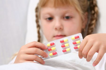 An image of a girl with pills in her hands Stock Photo - 3714011