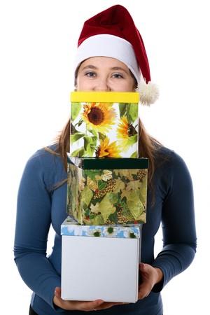 three gift boxes: Una ni�a sorprendida en un nuevo a�o con tope de tres cajas de regalo