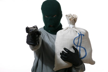 An image of a man in mask with gun and bag Stock Photo - 3964979