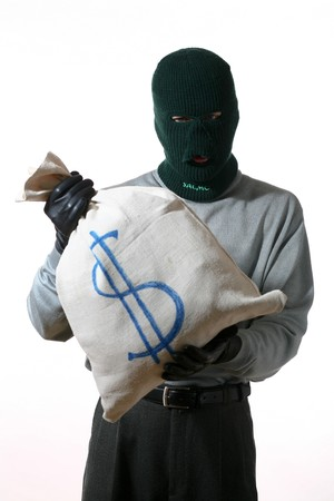 An image of a man in mask and sack with money Stock Photo - 3965095