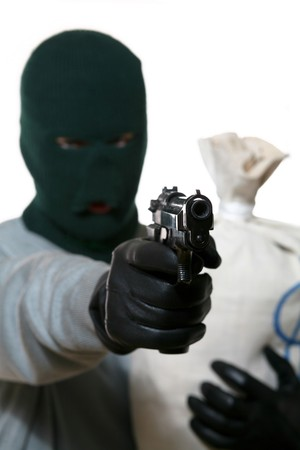 An image of a man in mask with gun and bag Stock Photo - 3965057