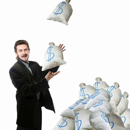 Una imagen de un hombre y sacos con dinero Foto de archivo - 3965014