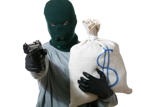 An image of a man in mask with gun and bag Stock Photo - 3981450