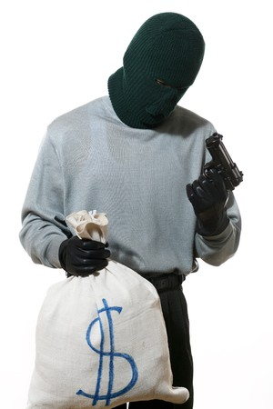 An image of a man with a bag and a gun Stock Photo - 4089637