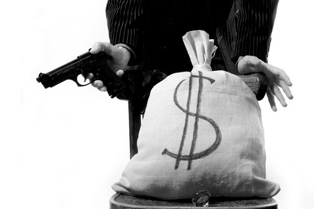 An image of a bag with money and a man standing behind it Stock Photo - 4089580