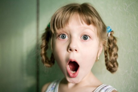 surprised child: Stock photo: an image of a surprised girl with open mouth Stock Photo