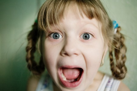Stock photo: an image of a  little girl with her mouth open
