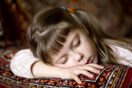 Stock photo: an image of a nice sleeping girl on a sofa