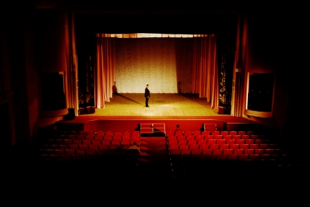 Stock photo: an image of man on the stage in empty hall