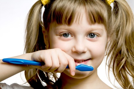 Stock photo: an image of a girl with toothbrush Stock Photo