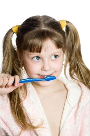 An image of a girl with blue toothbrush photo