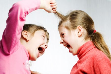 girl fighting: Stock photo: an image of two girls fighting and shouting