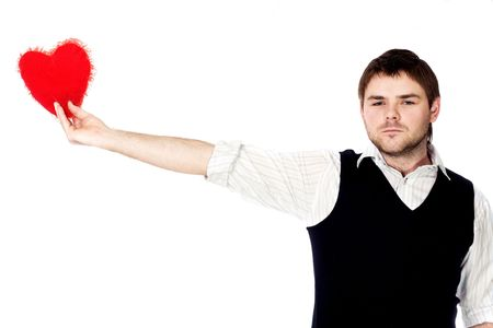 guile: A young man with his big scarlet heart in his outstretched  hand Stock Photo